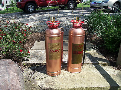 Extinguisher Lamps Both are 23 1/2 inches tall One Is FYR-FYTER and One STEMFIRE