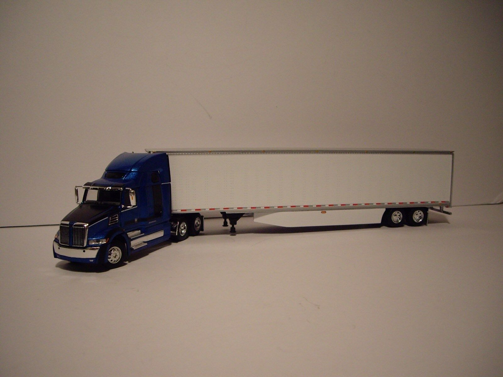 DCP 1/64 BLUE AND BLACK WESTERN STAR 5700XE W/T 68'' SLEEPER AND DRY VAN TRAILER