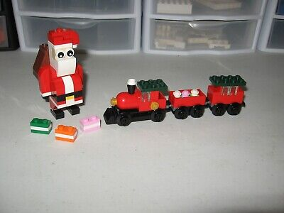 LEGO RETIRED JOLLY SANTA AND CHRISTMAS TRAIN PUT TOGETHER FOR PICTURES