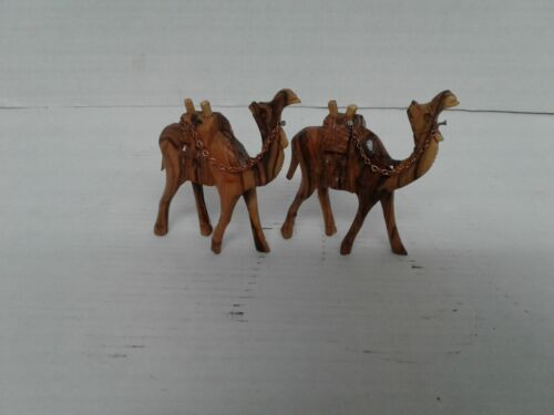 A Pair of hand carved olive wood camels