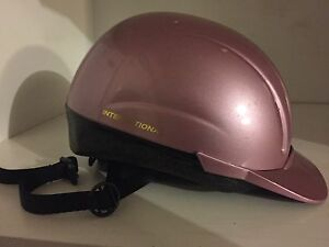 Horse riding helmet and insulated boots