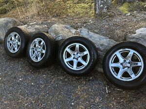 4 studded snow tires on aluminium rims