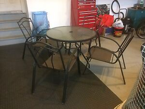 Patio Table Four Chairs and Cushions Excellent Condition!