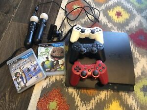 Sony ps3 with 3 controllers, camera, 2 motion controllers
