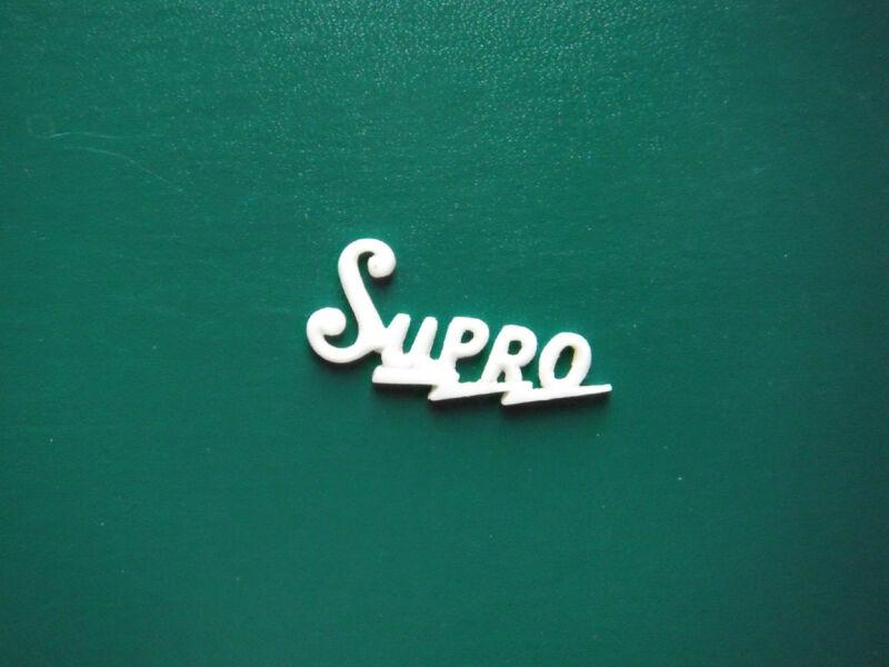 Supro Guitar Logo white