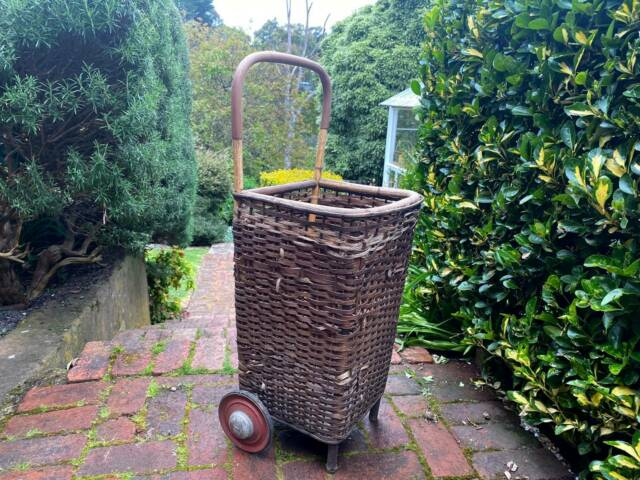 Vintage wicker cane shopping trolley or laundry basket ...