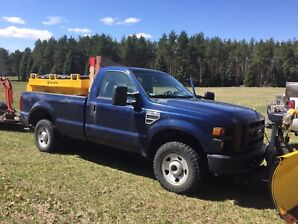 2010 f250 single cab with v blade plow and 7' fisher salter