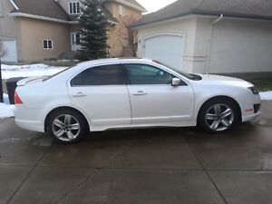 2011 White Ford Fusion V6 3.5L Sport AWD. Low kms