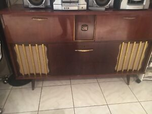 Antique record player, stereo , bar