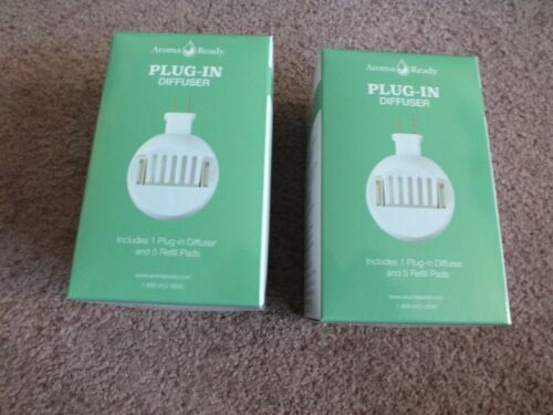 Plug In Diffuser for Essential Oils Set 2 New in Box Plug in Refill Pads