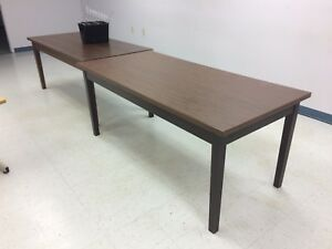 A variety of older desks, tables and Chairs
