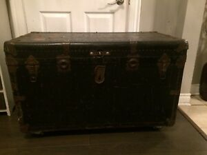 Vintage trunk on caster wheels