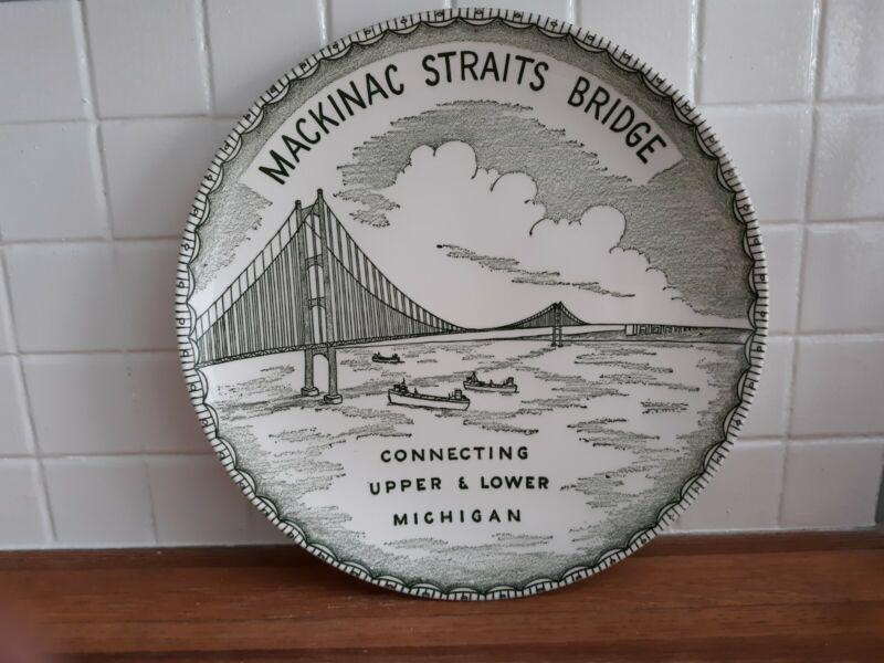 Green and white transferware Mackinac Bridge collector plate