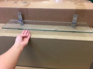 Pair of wall mounted glass shelves