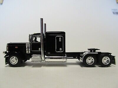 DCP FIRST GEAR 1/64 SCALE 389 PETERBILT FLAT TOP, BLACK & CHROME, FRAME COVER 1