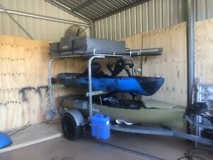 Kayak camper trailer with kayaks and roof top tent awning