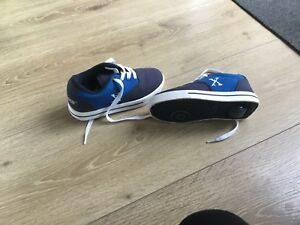 Brand new side walk roller skate shoes retail at $59:95