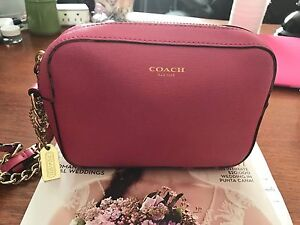 $ 25 authentic pink leather coach clutch .