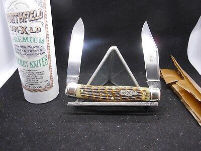 (GREAT EASTERN / NORTHFIELD MOOSE ANTIQUE AMBER JIGGED BONE KNIFE)