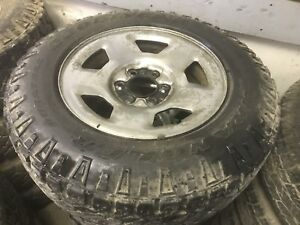 Lt245/70R17 good year wrangler winter tires and rims,