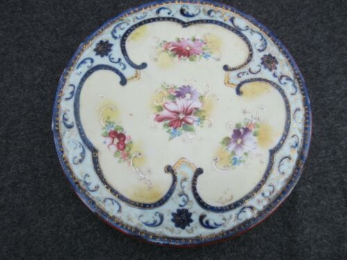 Beautiful Antique hand painted gilt floral porcelain round trivet hot plate