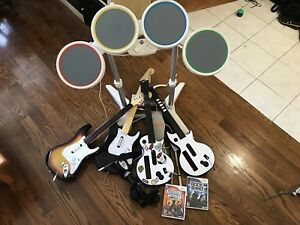 Wii 4 guitars, micro, drums, jeux