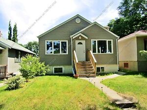 CHARACTER BUNGALOW W/ SECONDARY SUITE IN MATURE NEIGHBORHOOD