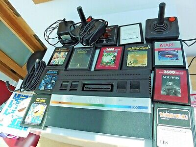 Atari 2600 Console. 11 games and joy sticks.
