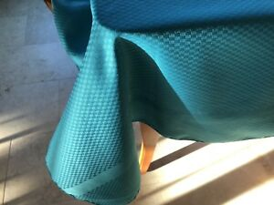 Teal polyester tablecloth. Excellent condition.