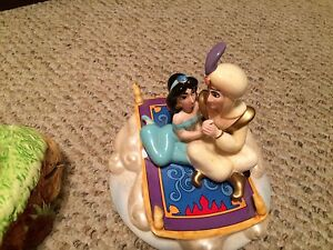 Aladdin and lion king porcelain musical collectables