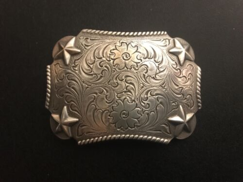 Floral engraved,Western,cowboy,rodeo,trophy,stars belt buckle.Silver plaiting .