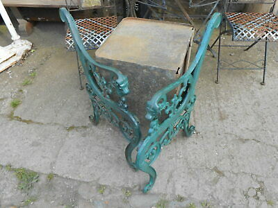 A PAIR OF RECLAIMED CAST IRON GARDEN BENCH ENDS