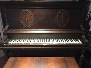 Vintage upright piano. Bell made in Guelph