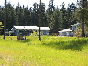 5 acre estate, luxurious main home, + rental incomes on property