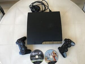 PlayStation ps3 video game console 2 joysticks 2 games complete