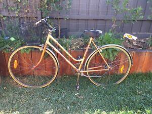 Vintage ladies step through bike. Needs a service.