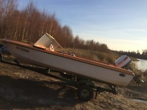 1976 glasstrong boat with 20hp Johnson Outboard