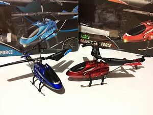 2 RC helicopters blue and red