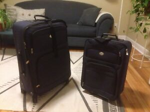 2 Luggage (one large and one carry-on)