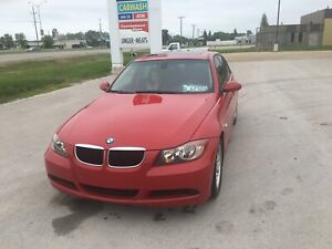 2007 BMW with very low km and new Safetied only $7250 obo