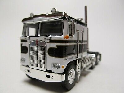 DCP 1/64 SCALE KENWORTH K-100 FLAT TOP, BLACK & WHITE, GOLD STRIPES, DUAL STACKS