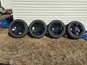 Set of 4 wheels and tires for sale.