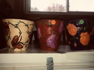 Assorted painted flower pots