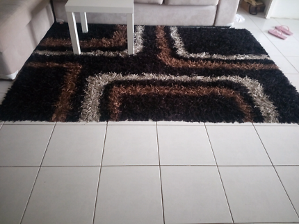 Very stylish rug  very good condition almost like  new