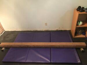 Gymnastics balance beam and mat