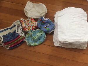 Cloth Diapers - 19 prefolds and 10 covers