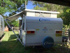 Compass pop top caravan 17ft. As new.