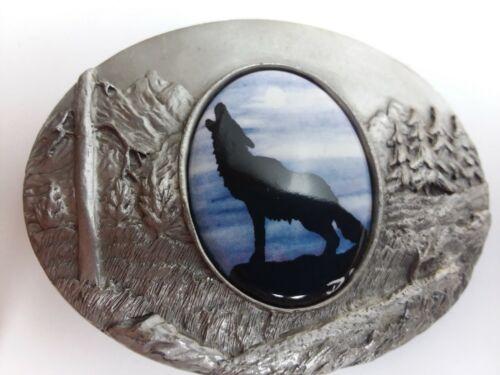 Artistic Impression coyote howling belt buckle designed by Julie Zsupnik  2004
