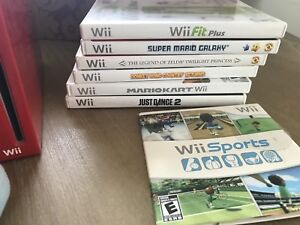 Nintendo Wii with games and Wii Fit Scale