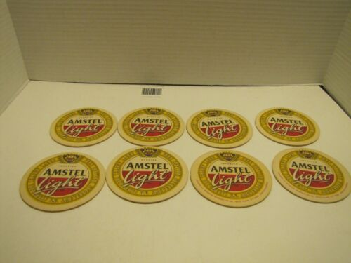 LOT OF 8 AMSTEL LIGHT HEAVY CARDBOARD COASTERS USED